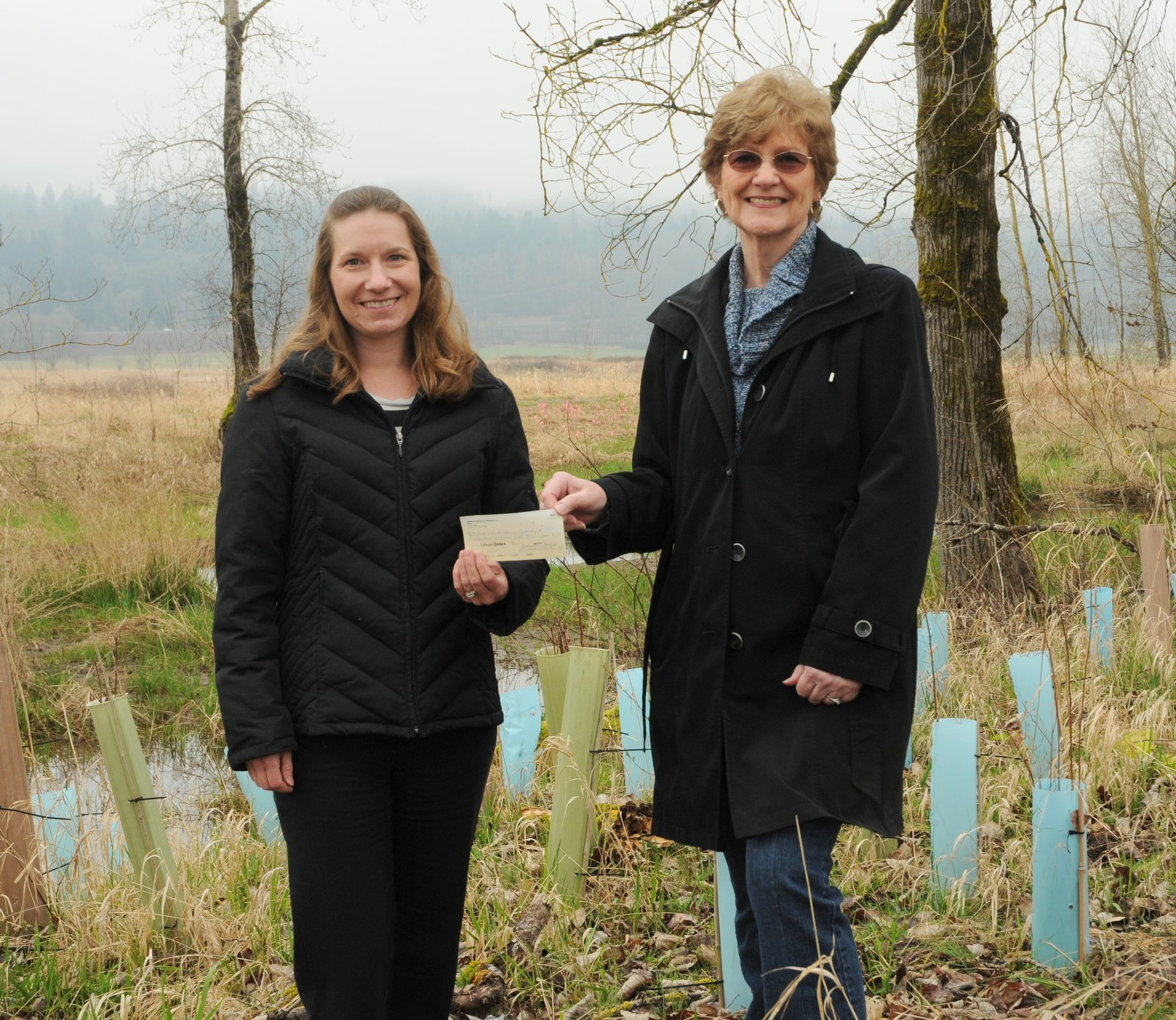 Treasurer Marianne distributing 2013 grant to Lower Columbia Estuary Partnership