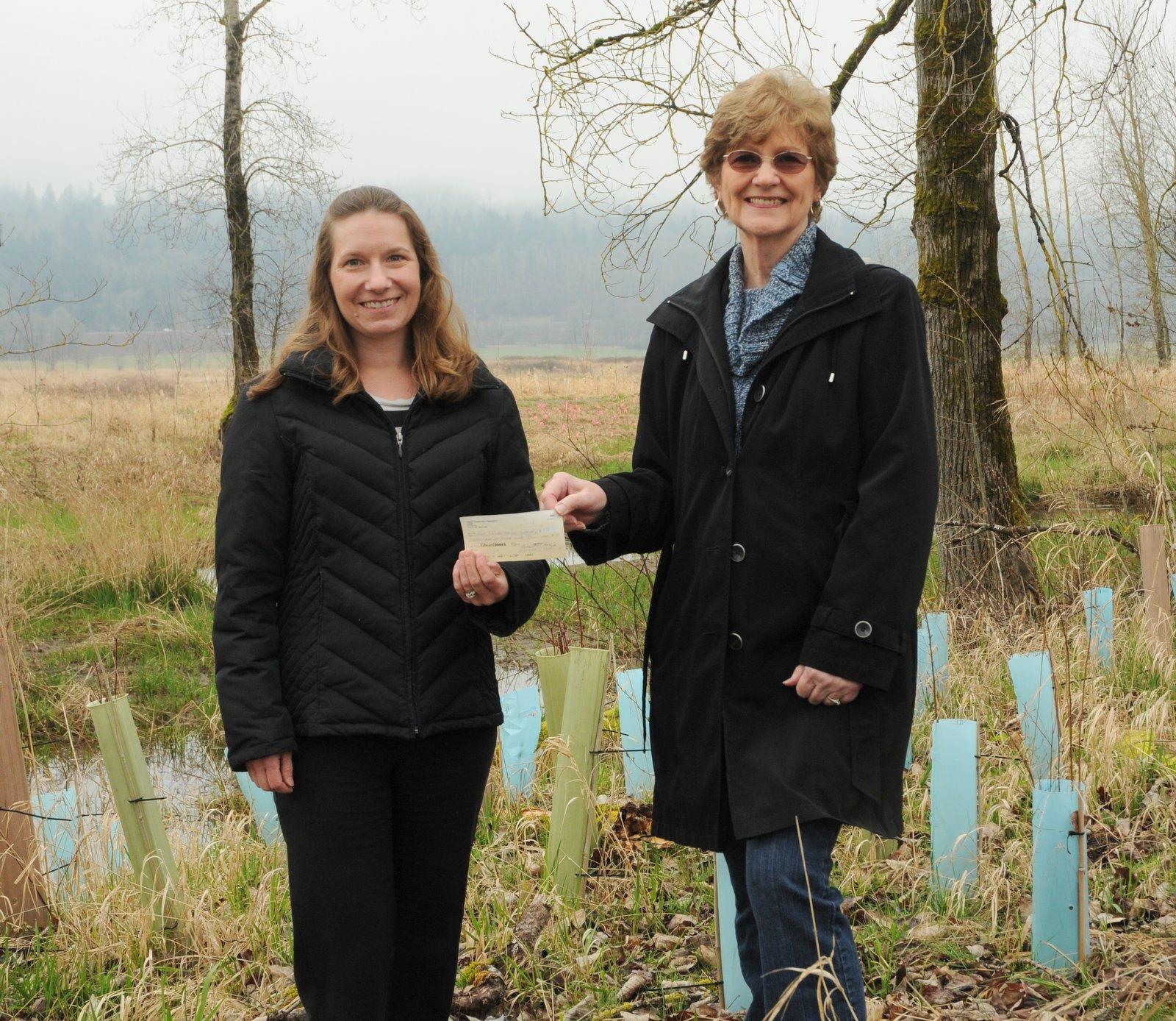 Treasurer Marianne distributing 2013 grant to Lower Columbia Estuary Partnership